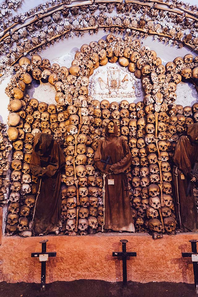 One of the most bizarre and beautiful places to visit in Rome is the Capuchin Crypt. This catacomb and museum is a small area located underneath the little church of Santa Maria della Concezione dei Cappuccini. Hidden in one of Rome's major piazzas, the Piazza Barberini on the Via Veneto, this tiny space underneath a church is home to the remains of no less than 4,000 Capuchin monks, brought here in 300 carts when the monks moved in. All the bones are displayed in a beautiful way - for some people I might add - over the walls and ceiling.