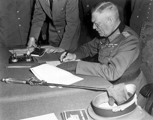 Field Marshall Wilhelm Keitel, signing the ratified surrender terms for the German Army at Russian Headquarters in Berlin, Germany, May 7, 1945. Lt. Moore. (Army) NARA FILE #: 111-SC-206292 WAR & CONFLICT BOOK #: 1353