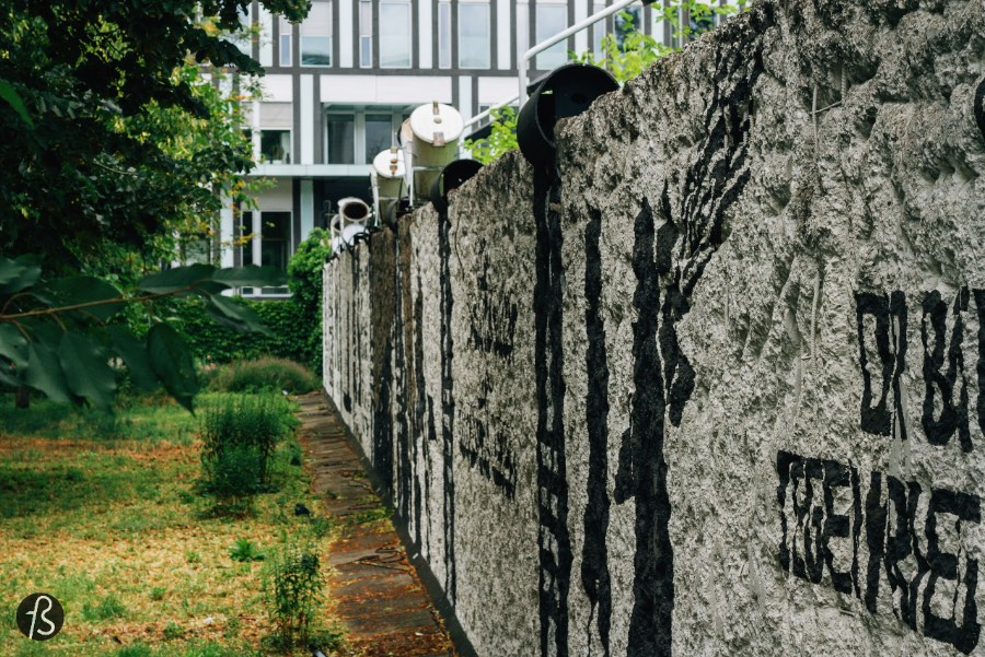 The installation was created back in 1990, right after the fall of the Berlin Wall, and it's made of trees, memorial stones, some parts and pieces of the border fortifications and the names of the 258 people that died trying to cross the Berlin Wall.