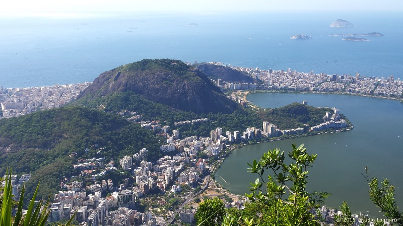 Rio de Janeiro - City of Wonders_Chosen in 2007 as one of the New 7 Wonders of the World, Christ the Redeemer, the one whom welcome with his open arms people from everywhere, is known much earlier than that. To me, one of the top 5 sites you must visit before you die, unmatched and different from any other monument, Christ Redeemer is located on the top of Mount Corcovado in the Tijuca Forest, with 38 meters tall, 30 of the Monument and 8 of the pedestal.
