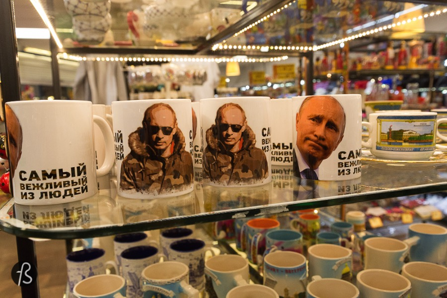 In Russia, the souvenir is Putin Funny and scary at the same time =D Can somebody please translate what those mugs and t-shirts say?