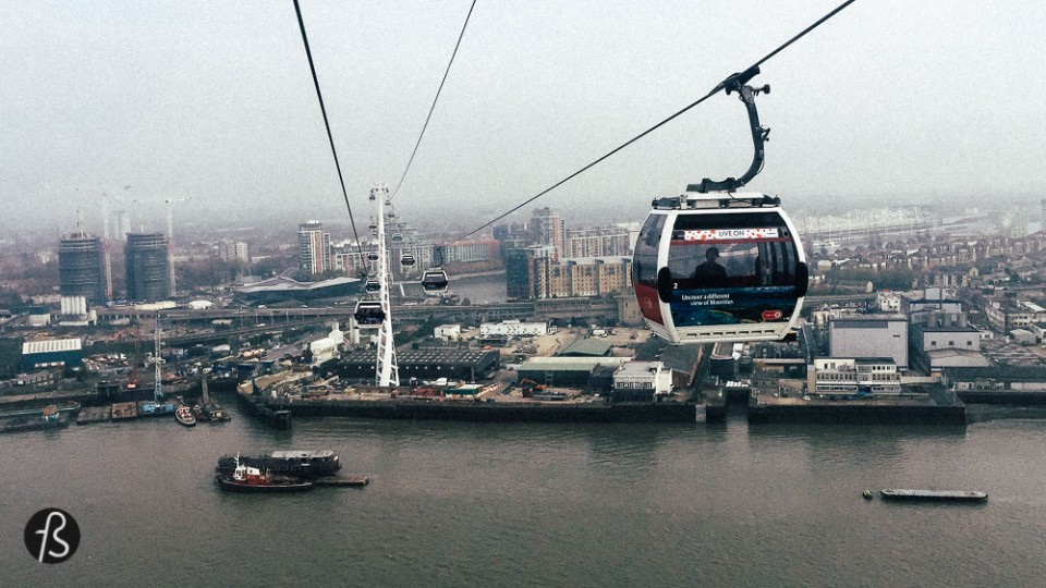 london on a budget Emirates Air line Close to the O2 arena in London you can find the Emirates Air line. Cable cars with 6 seats, filled with windows that cross the River Thames giving you an iconic view of the city. London's landscape never looked that better. I've never had the chance to go to the London Eye so I can not compare the views, but the cable cars are for sure cheaper. With tickets going from as low as £3.40, this experience is a must for all instagrammers and photographers. Choose a clear day and come back to see the city at night. I took this line on both directions in November and it was the highlight of my day.