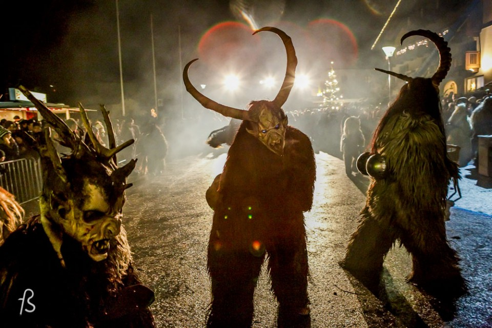 Please meet Krampus, Santa Claus' shadow. Krampus is horrific beast that is half-demon and half-goat who, literally, beats children up from naughty to nice. Krampus isn't exactly what you expect for Christmas, I assure you. Dark long fur, horns and fangs, this creature is St. Nicholas' shadow and it comes with a chain and cow-bells that he whip about, along with a bunch of birch sticks meant to hit naughty children. It then kidnaps the bad kids and take them down to the underworld.