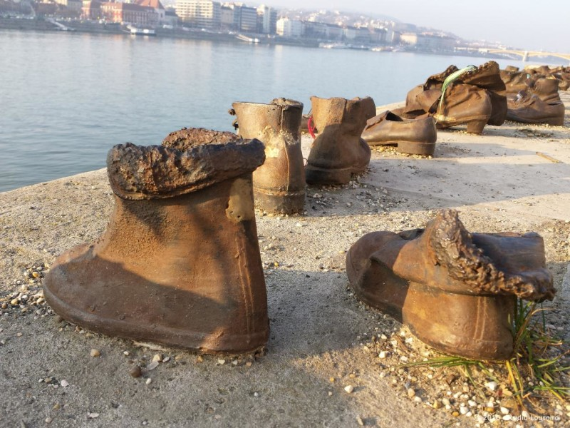Also, on the edge of the beautiful Danube, almost in front of the back of the Parliament, you can see a homage to the Jews killed by the fascist Arrow Cross during the WWII, the monument Shoes on the Danube Bank. The Jews, back then, were ordered to take off their shoes, and were shot at the edge of the water so that their bodies fell into the river to be carried away. There are sixty pairs of iron shoes created by the sculptor Gyula Pauer. In my opinion, one of the most moving monuments within the city.