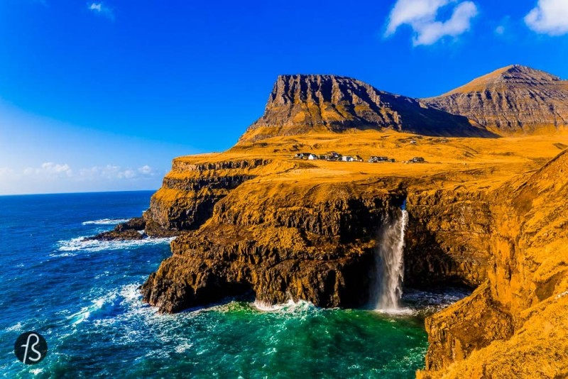 What is the cheapest way to get to the Faroes?gasadalur On the west side of an island called Vágar is where you are going to find Gásadalur, one of the most beautiful places we ever saw in our lives. This village in Faroe Islands is know for a waterfall that we decided to describe as nature wallpaper based on how amazing it looks like. The pictures below are going to be enough to convince you to take a plane and visit this amazing country located between Scotland, Iceland and Norway.