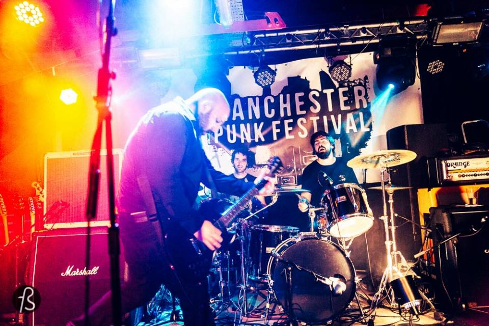Check a live Manchester Show with real Manchester Bands My brief visit to Manchester happened because I went to see the super cool Manchester Punk Festival. This year the line up had big names like the Flatliners, Bouncing Souls and Oi Polloi. I will admit here that my 16 years old self was so happy to finally see Oi Polloi live that I cannot put into words here. oi polloi manchester punk festival music live bands