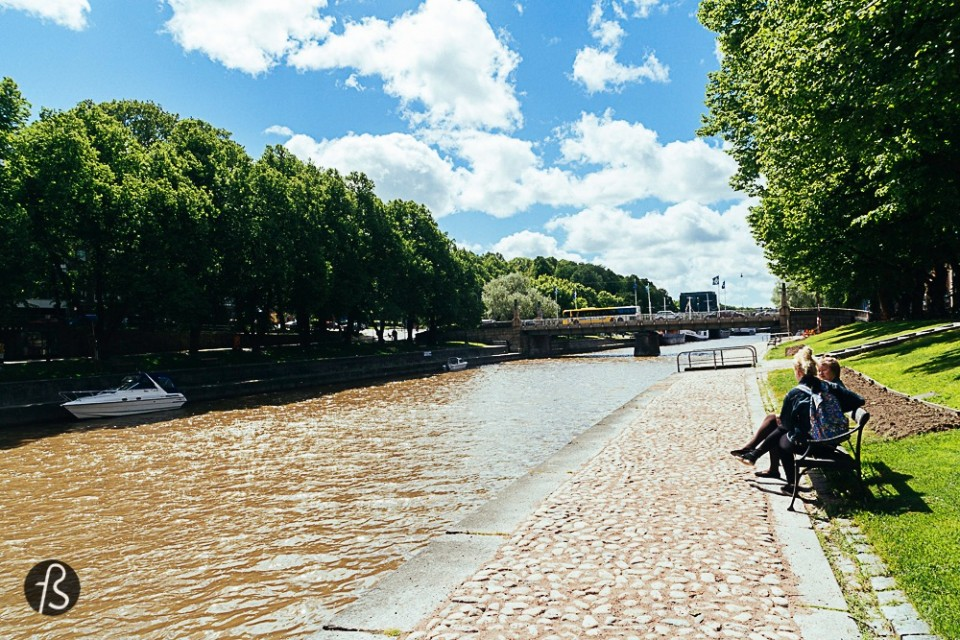 Stroll around the Aura River Aura is the name of the most important river in Turku. It cross the city almost in the middle and along the riverbank there are several places to sit down, restaurants inside ships and boats, bars and much more. If the weather is nice, I strongly recommend to just stop by in a local supermarket, get something for a picnic and just have a nice day with your loved one or friends. Turku's landscape is great, the city is full of colors and life, there are many green spots to visit and if you're in a picnic, you can drink outside in Finland.