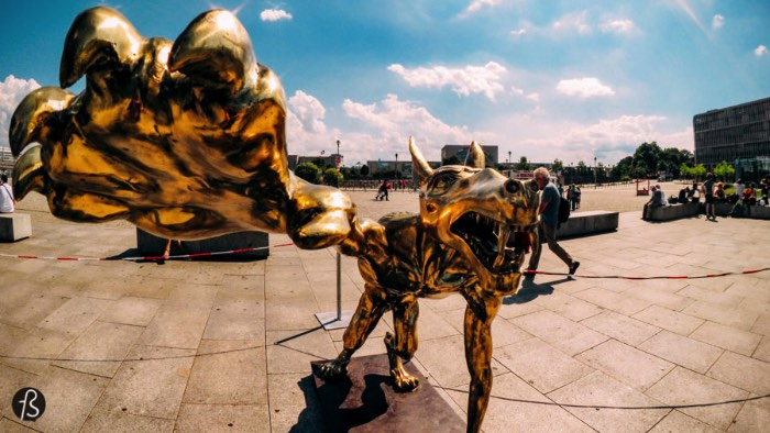 In early August, If you arrived in Berlin via Hauptbahnhof you would be greeted by a pack of wolves. Bronze and iron statues, some of them with more than 2 meters in height, would be looming over passengers with guns and Nazi salutes. A sign would tell you that the Wolves are Back. But why are these Wolves back in Berlin?