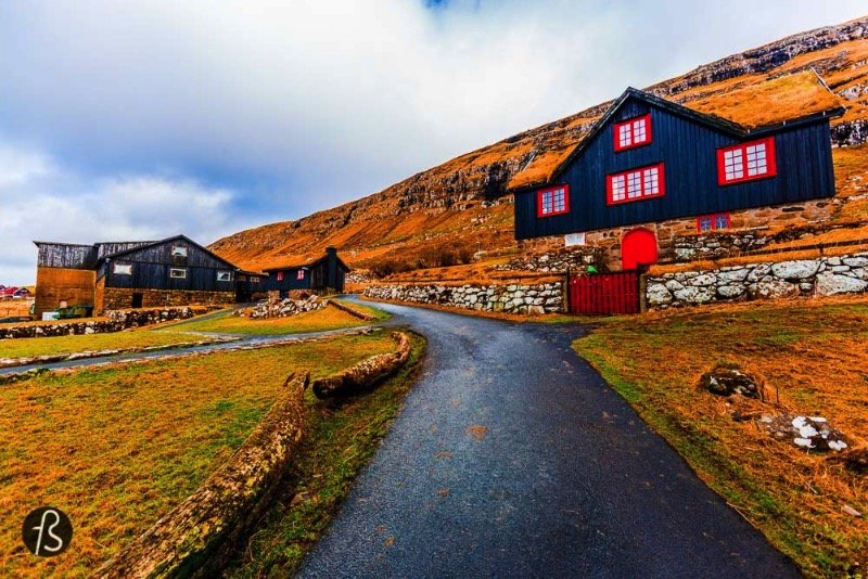 We didn't know it back when we visited Kirkjubøur Village but the beautiful black wood house with red doors is the oldest still inhabited wooden houses of the world. Called Kirkjubøargarður, which means Yard of Kirkjubøur in Faroese, is the largest farm in the Faroe Islands and it has always been. The building dates back to the 11th century and it was the episcopal residence and seminary of the Diocese of the Faroe Islands since then.