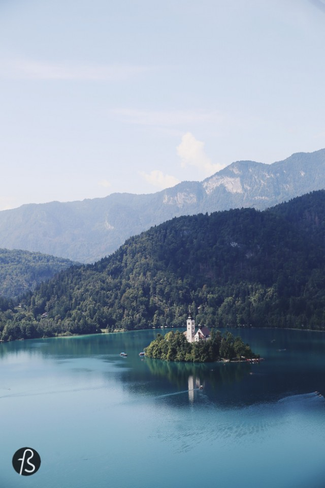 things to do in slovenia - lake bled - The super famous post card of Slovenia If you're familiar with Slovenia, you know my 2nd item in this list of things to do in Slovenia, right? Lake Bled! Lake Bled is for sure one of the prettiest places on Earth. I'm not kidding. The only bad thing about it is the amount of tourists, of course. But you can't expect a gorgeous place like that to be empty, right? Bled is the lake and a village near the lake. The lake has a lovely Castle on the top of a mountain and a church isolated in the island located inside the lake, Bled Island. The view is fantastic from everywhere you go, so go crazy. I never made it to the Bled Island because there was a wedding happening there as far as I heard. I can't blame a couple for wanting to get married there, so I wasn't pissed. Lake Bled has a magnificent blue color because it has partially glacial and partially tectonic origins. The lake is situated in a picturesque environment, surrounded by forests and mountains. The medieval Bled Castle stands above the lake on the north. The Zaka Valley lies at the west end of the lake, giving this place the fame for being the postcard of Slovenia. On the top of Bled Castle, you can find a wine shop, museums, restaurants and a forge with a very rude dude that takes pride on mistreating its costumers. Please don't mind him because the whole experience too damn awesome for that. You can tell him that I wrote this about him here, I told him I would.
