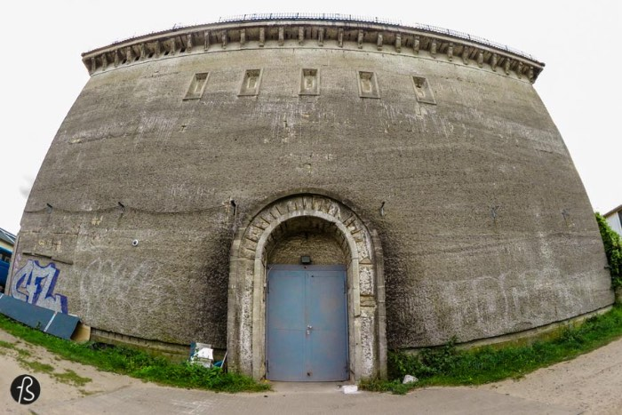 You have to go all the way to Wittenau to see what we are calling the Twin Bunkers of Witten Strasse. Both Hochbunkers were built in September 1940 with orders from Albert Speer and, by 1941, they were ready to protect the local population.  The weirdest thing about those two bunkers is that they are being used by a car repair shop and there are cars everywhere there. If I had a car, I know that I would drive all the way there just to have it fixed in a place that used to be a Second World War bunker. Weird, right?