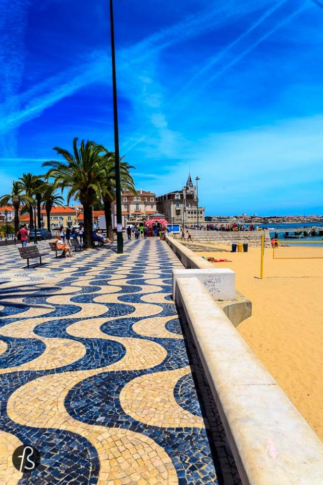 """Go a bit further now If you take a 30~45 minutes train ride you will arrive in Cascais. And believe me you want to do this item on the list of things to do in Lisbon – and maybe transform into """"things to do in Lisbon and around""""??. Cascais is so beautiful that deserves a whole post dedicated to its beauty. It is where nature meets perfection. From Cascais main beach to Boca do Inferno (Hell's mouth) to Cascais Art District to its wonderful streets. This place will for sure amaze you. There are several day trips you can take from Lisbon and if you know the minimum about this city, you know what I'm talking about. Sintra, Cabo da Roca and National Palace of Queluz are some of the names. But I didn't have much time in Lisbon so I decided to do only Cascais. I rather get to spend a whole and enjoyable day in one place than do two or three in a hurry. The small village of Cascais is about 25 kilometers west of Lisbon.You just need to get the train to Cais do Sodré-Cascais and you're there. Go before lunch and stay until the sunset. You'll have more than enough time to enjoy this piece of heaven if you save 1 entire day for it. Cascais combines tradition with nobility. This place evolved from a simple fishing port to what it is after the King Luis I moved to what is today the Cascais Art District, the Palácio da Cidadela. This citadel hosts a 5 star hotel, art exhibitions and occasional high class events. Think of Cascais as a glamorous and cosmopolitan destination rather than just a nice place to visit. You can easily walk around Cascais and there's no need for taking a bus or taxi. Keep in mind that if you want to reach places like Boca do Inferno and Casa das Histórias, you must wear comfortable shoes. It is a nice walk but in total from the old town to Boca do Inferno, I took around 30 to 40 minutes walking slowly and taking loads of breaks for photos. I would recommend you to do all the walking and photo part of your visit before you decide to lay on the beach and en"""