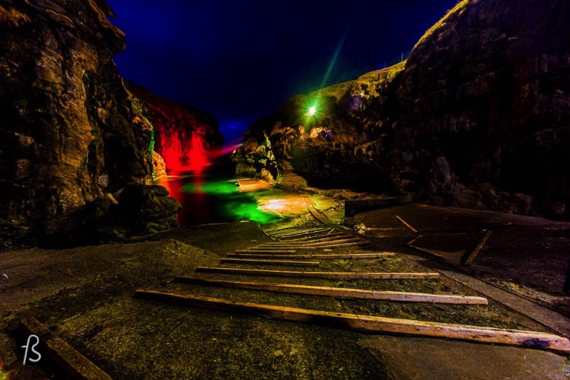 The gorge that gives name to the village is one of the best natural harbors in the Faroe Islands. But things are not that simple. Boats need to be pulled up on a ramp to keep them safe from the water. During the night, there are colorful lights all around and they make the gorge even more beautiful. An amazing opportunity to take even more pictures.