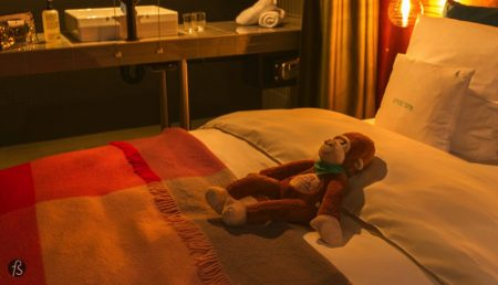 The bed was perfect for my taste, and a plush monkey was laying there when I got to the hotel. Like it was protecting my bed from whoever might have come before me. There was also a surprise for me with a small bottle of KR/23 liquor and a small bag filled toiletries.