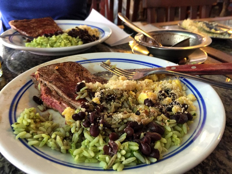 Our List of Cheap Places to eat in Rio de Janeiro _ Cantinho do Leblon is one of those places that you'll find out ONLY if you have a local friend in Rio de Janeiro. But since you have me, your favorite Brazilian girl, you have everything! This place is located just a few blocks from the beach, the food is incredible, 100% Brazilian food and the portions are so big that one dish was enough for me and another girlfriend to eat and take away the rest. So I guess that if you come from a cave and you can eat like an ogre, maybe you won't take anything away. But you'll share. Trust me; it is a lot of food!!!