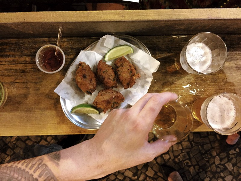 Our List of Cheap Places to eat in Rio de Janeiro _ Pavão Azul (Blue Peacock) is one of the most traditional places in Copacabana. And I can't choose if I like the pastel or the bolinho de bacalhau more. I guess you have to go there and try everything, you know? I understand that it is a hard task, but somebody's gotta do it. And this person is you. I urge you to go and have great food for an honest price while you experience one of the most amazing rituals of my country: the boteco way of life.
