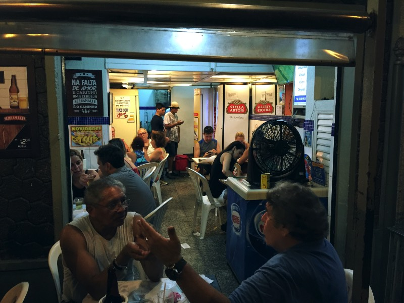 Pavão Azul (Blue Peacock) is one of the most traditional places in Copacabana. And I can't choose if I like the pastel or the bolinho de bacalhau more. I guess you have to go there and try everything, you know? I understand that it is a hard task, but somebody's gotta do it. And this person is you. I urge you to go and have great food for an honest price while you experience one of the most amazing rituals of my country: the boteco way of life.