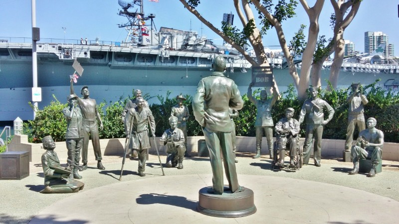 San Diego's Downtown Harbor and Bob Hope Tribute Another San Diego must-see is the downtown harbor. As you stroll along the waterfront, you will see cruise ships preparing to embark, historic merchant vessels, the USS Midway museum, and the quaint Seaport Village where you can ride an antique carousel or eat in a harborside restaurant. My personal favorite is Tuna Harbor Park, right next to the USS Midway. There's a Bob Hope tribute there and a huge replica of the 'Kissing Sailor' statue. You can bring a picnic here or meander down to the 'G' Street pier and watch the fishermen get their nets and traps ready.