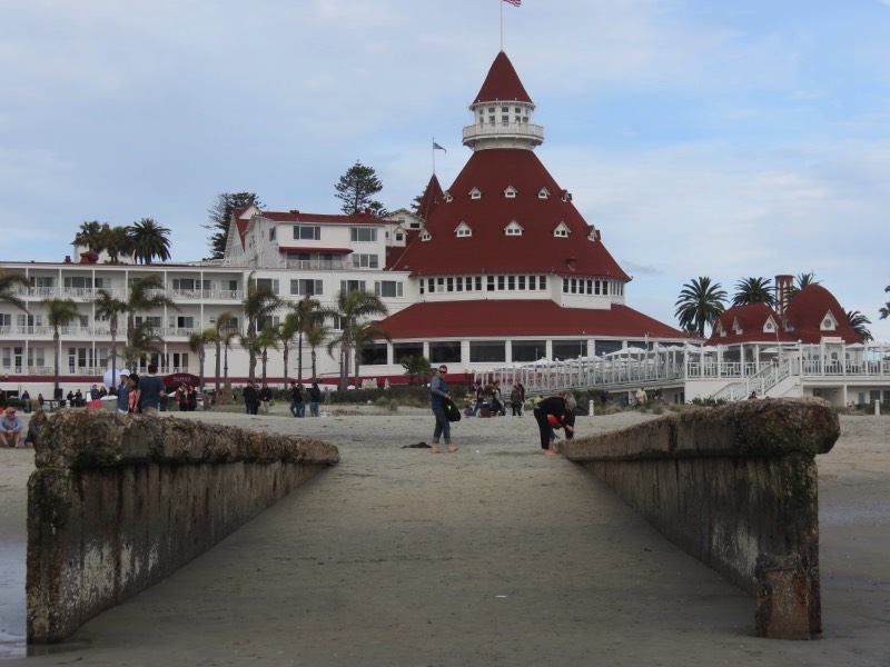 A Visit to Coronado Island Coronado Island is a beautiful neighborhood of San Diego which can be reached by crossing the sweeping Coronado bridge. Homes in Coronado have steep prices, and it's no wonder -- everyone is within walking distance of the beach. The most famous landmark is the historic Hotel del Coronado, with its Victorian architecture and storied past. Marilyn Monroe once filmed a movie there! A visit to Coronado Island must include a stroll down Orange Avenue to see the many boutique shops and art galleries. Renting a bicycle is also a great way to get around.