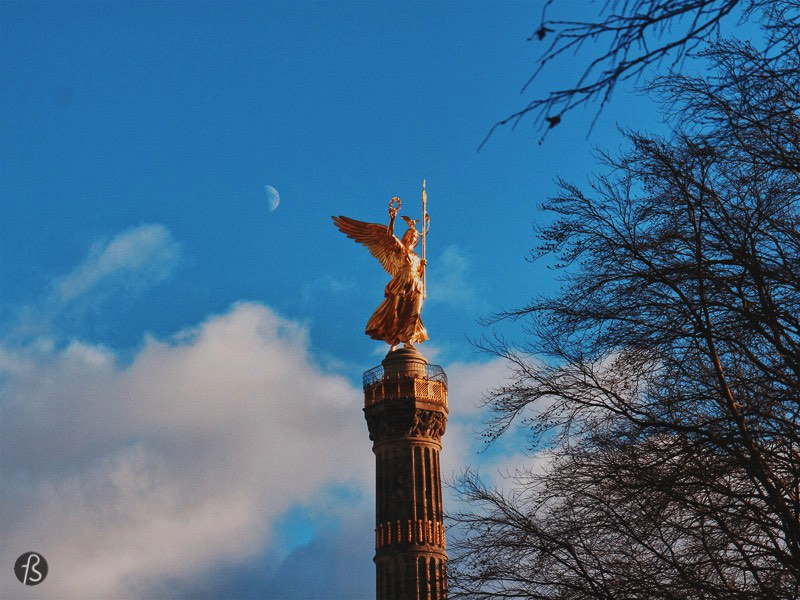 The golden sculpture on top of the column is made of bronze and weighs 35 tons, measuring a little over 8 meters. Friedrich Drake created the artwork; the statue was first intended to celebrate Prussia's victory over Denmark in the Second Schleswig War in 1864. But, by the time it was finished, Prussia was celebrating victories in the Austro-Prussian War in 1866, and the Franco-Prussian War from 1870 to 1871. Those are known as the Wars of German Unification, and this is the story that you find in the mosaics and bronze reliefs around the base of the column.