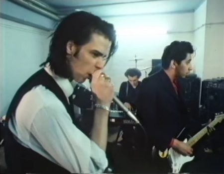 During the years where Nick Cave was living in Berlin, back in the 1980's, he was filmed for a Dutch documentary called Stranger in a Strange Land. Produced by Bram van Splunteren for the Dutch TV channel VPRO, you get a glimpse of the life of Nick Cave in Berlin even though some parts of the movie are voice-over in dutch. But you don't need to worry about it, all the interviews with Nick Cave are in English.