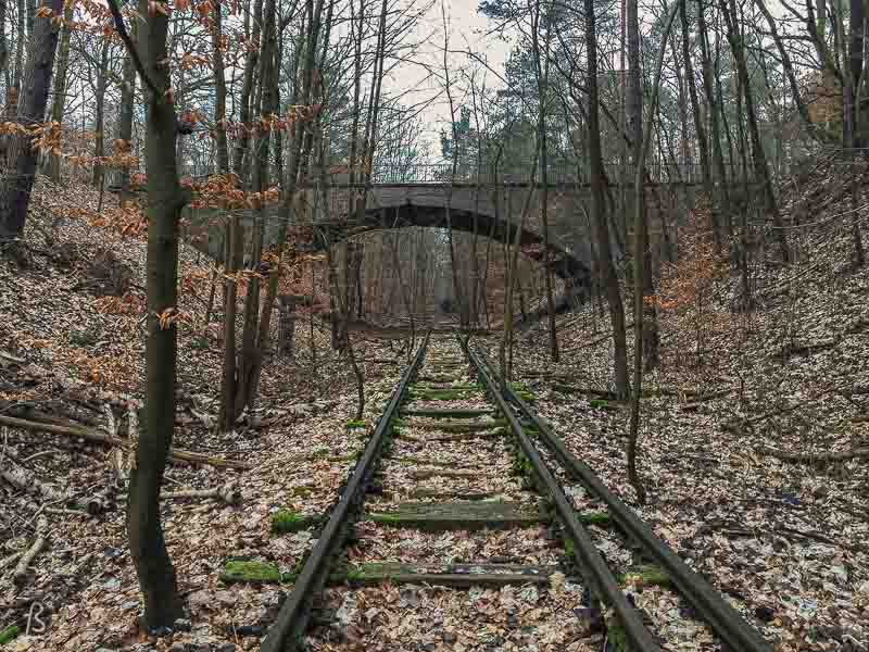 Here we will talk a little bit about the reason why the Friedhofsbahn was built, how it shut down, and why some people want it back. Also, since this is the same abandoned train track used as a location in Netflix's series Dark, we will talk about the hike in the forest, following the train tracks the connect the bridge to the church in Dark.