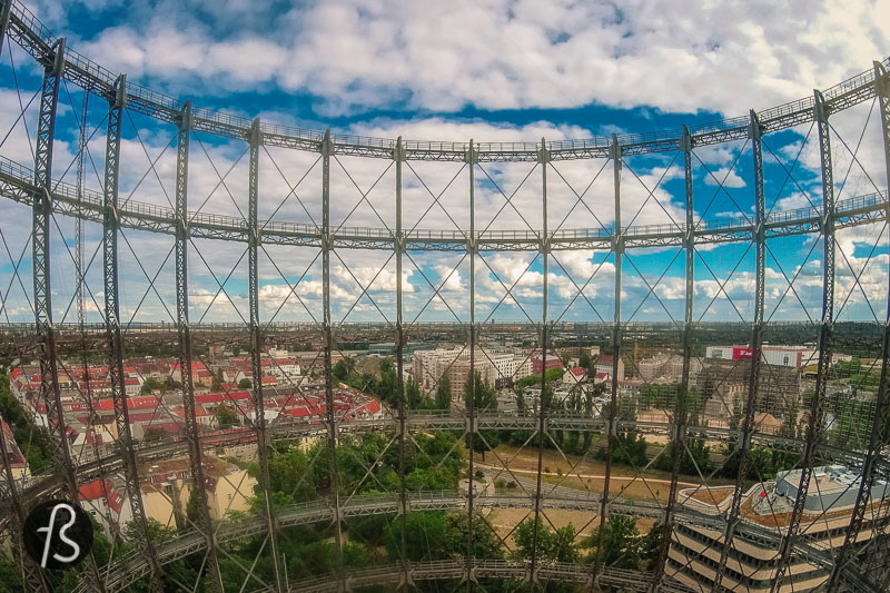 """The 360º view from the Schöneberg Gasometer is exciting. It allows you to observe a part of Berlin that isn't covered in tall buildings. From there, you can clearly see the Rathaus Schöneberg, where Kennedy gave the speech made famous by """"Ich bin ein Berliner."""" On the other side, you can see the buildings around Potsdamer Platz and the Sony Center, Alexanderplatz and the TV Tower, and the vast Tempelhofer Feld. In the distance, you can see Teufelsberg alone on a hill."""