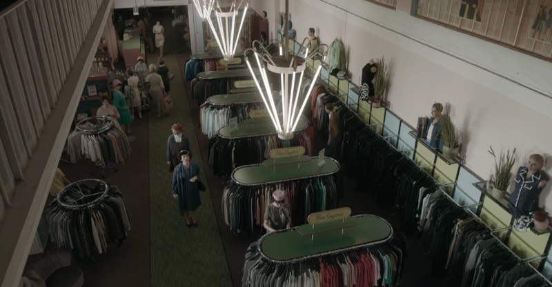 I believe it happens in the second episode when Beth's adoptive mother takes her shopping. There is an outside scene where they cross a road that is clearly not in Berlin. But once they are in the shop, they are back in Germany. The exterior shots were done in Toronto, but inside, they are in Berlin-Friedrichshain.